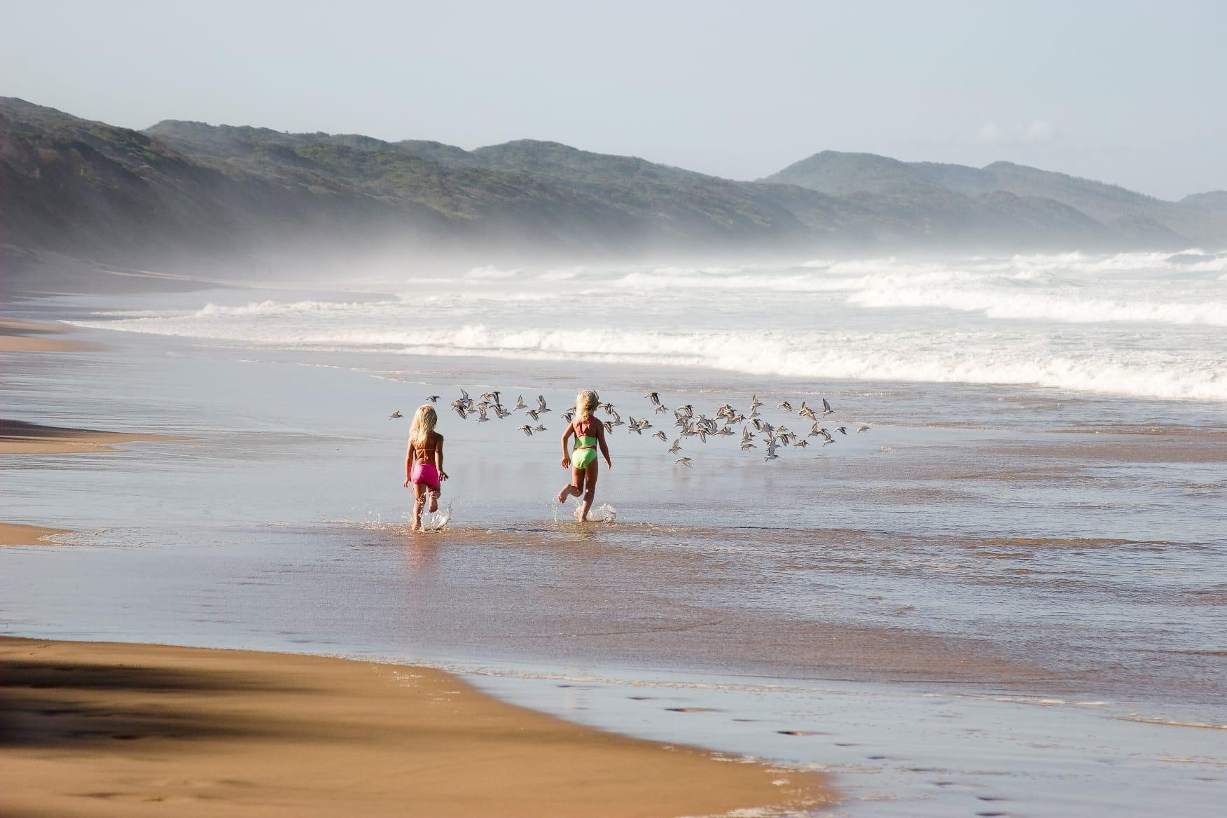 Kids running on Thonga Beach