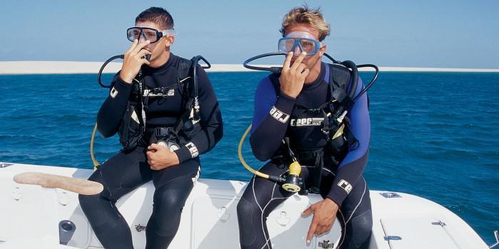 Boys diving at Anantara Bazaruto