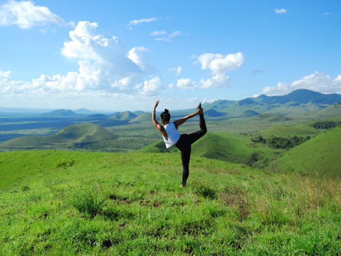 yoga instructor tricia cruz practicing at campi ya kanzi