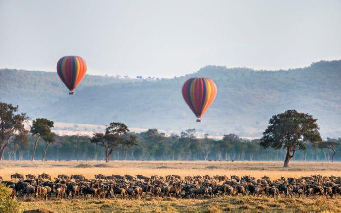 Kenya, Masai Mara, Narok County, Masai Mara National Reserve, Hot air balloons floating over landscape Wildebeest migration