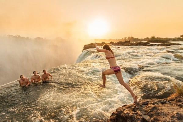 Jumping into Devils Pool, Victoria Falls, Zambia