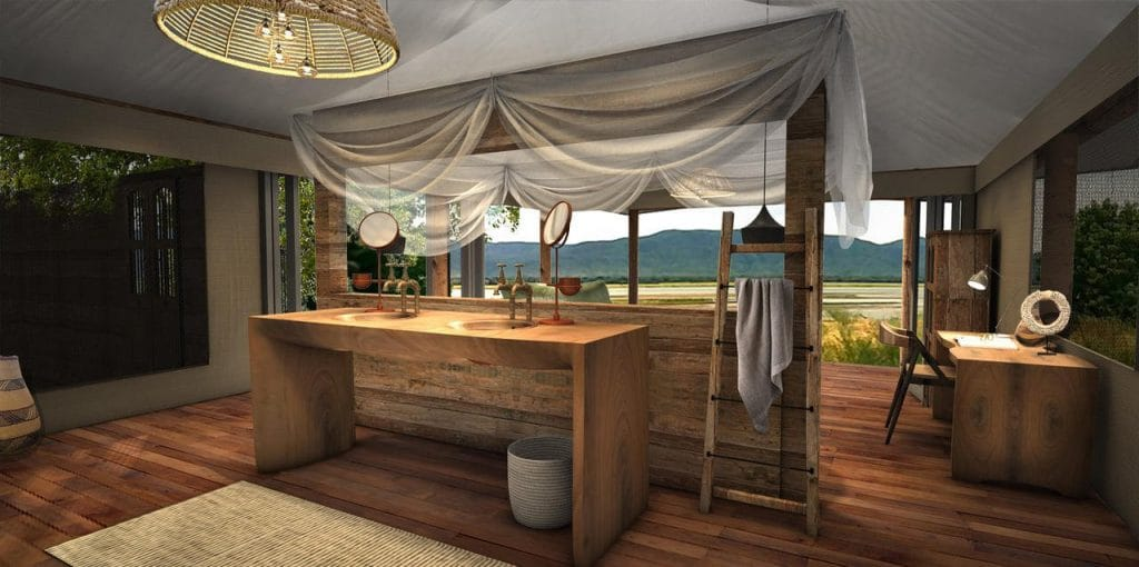 The en suite's double vanity frames one of the most dramatic vistas in Africa!