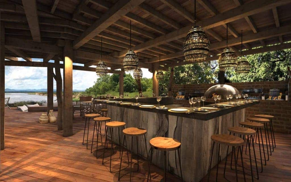 The downstairs bar opens out onto the verandah's magnificent river views
