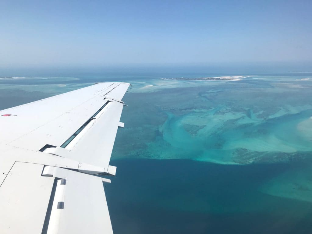 Flying in over the startling turquoise and cobalt depths of Southern Mozambique's ocean.
