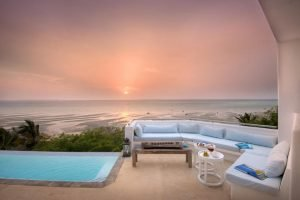 Rooftop lounge area at Santorini Mozambique overlooking the ocean at sunset