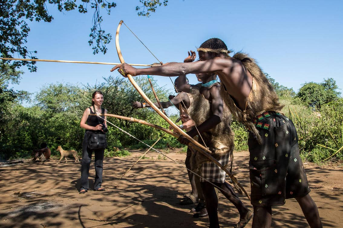 Hadzabe tribesmen show a visitor how to shoot a bow and arrow - Ngorongoro Crater, Tanzania