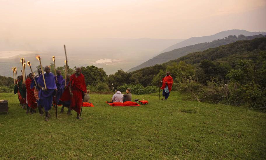 Maasai warriors performing a traditional singing and drummimg performance on the lawns of the Ngorongoro Crater Lodge