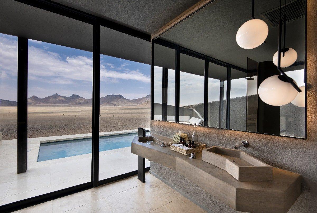 Floor-to-ceiling windows showing the Sossusvlei Desert
