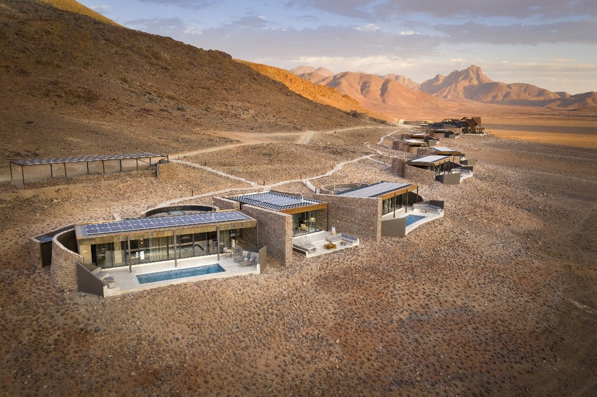 Aerial view of the Star Dune Suite with the other suites curving back around the desert landscape - &Beyond Sossusvlei Desert Lodge, Namibia