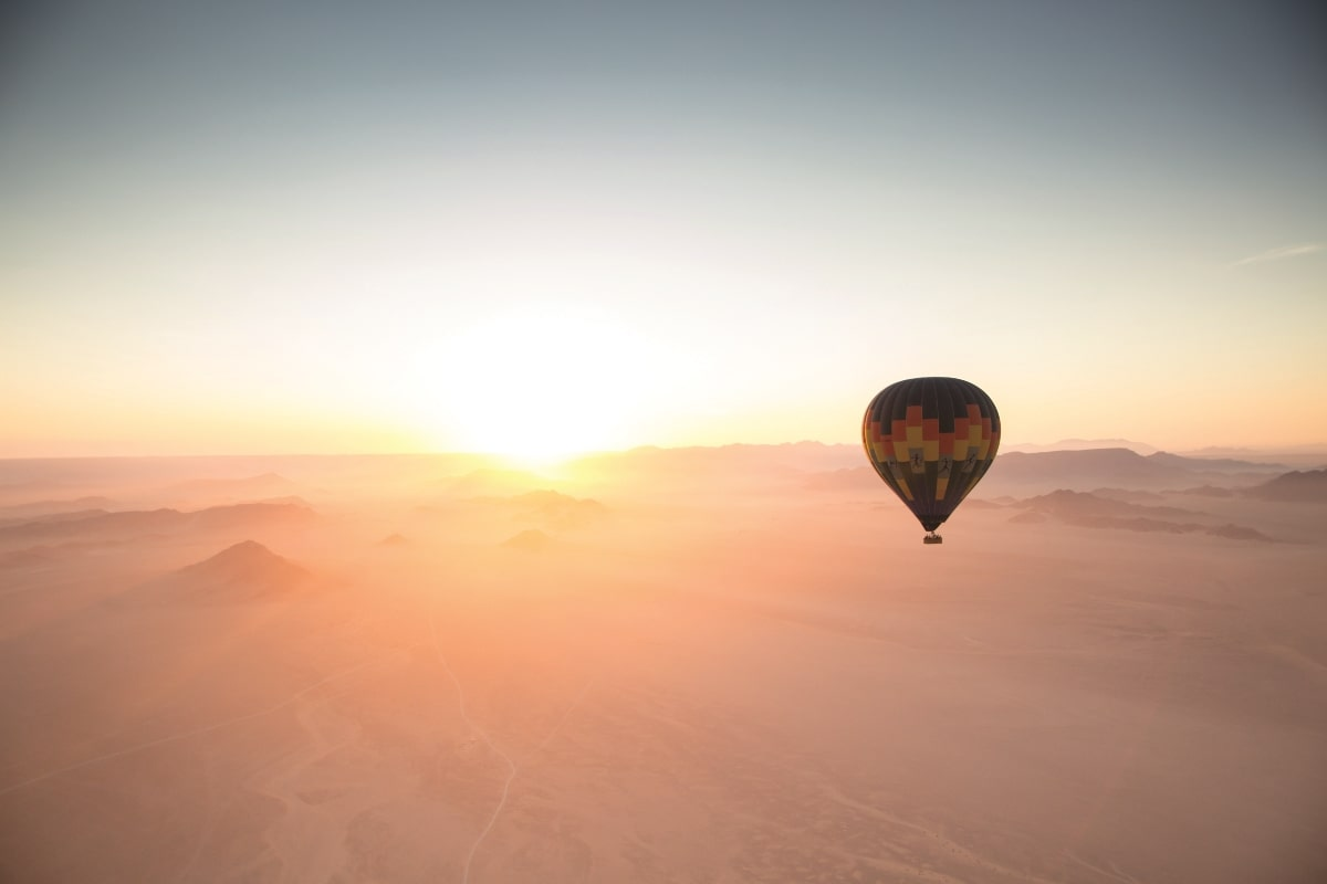 Hot air balloon over the Sossusvlei Desert at dawn in Namibia