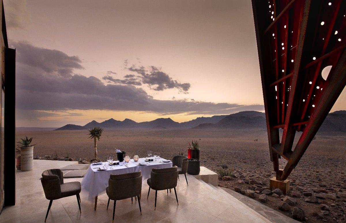 Outdoor dining area at dusk -- Sossusvlei Desert Lodge, Namibia