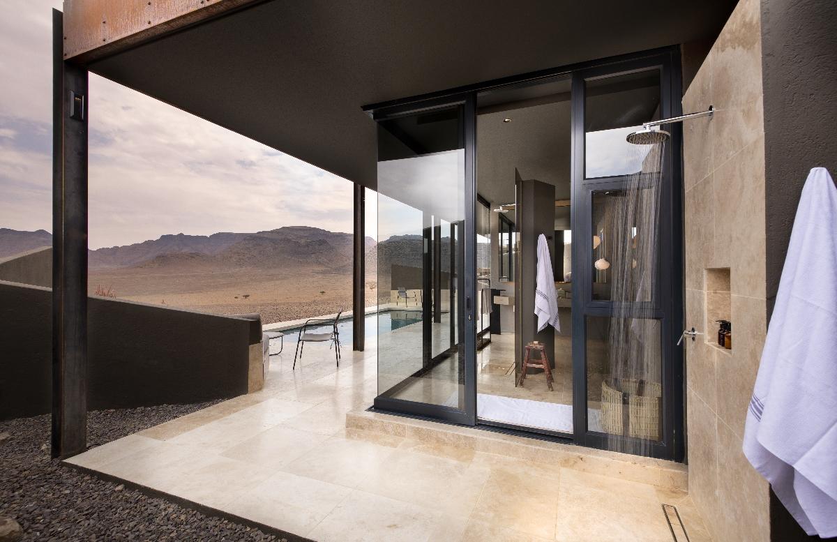 Outdoor shower overlooking the vast desert at &Beyond Sossusvlei Desert Lodge in Namibia