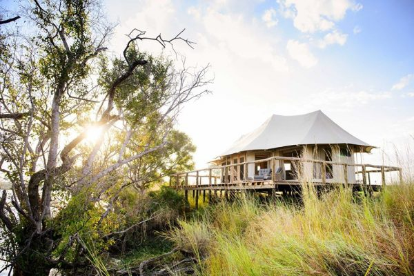 A Safari For Purists - river lodge at sunset - Ila Lodge - Southern Destinations