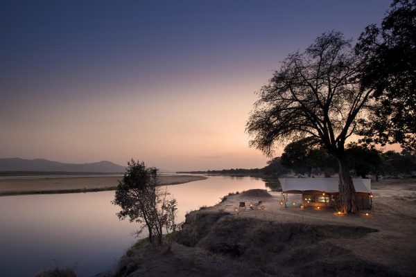 A Safari For Purists - camp at sunset - African Bush Camps Zambezi Expeditions - Zambia - Southern Destinations